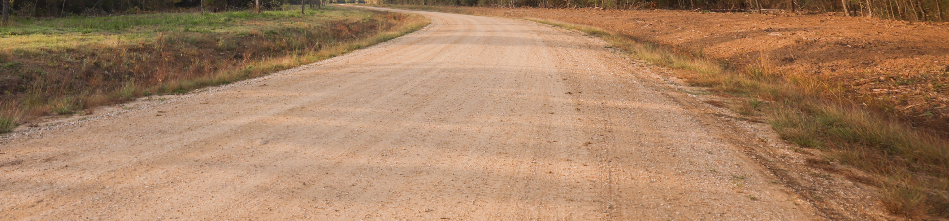 Perma-Zyme Unpaved Road Header